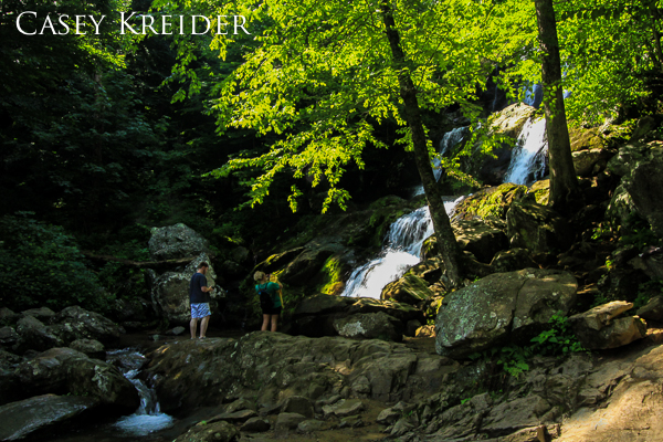 Hikers snap photos at the base of 70-foot Dark Hollow Falls while I grumble about the inaccurate weather forecast in Shenandoah National Park, July 28, 2013.