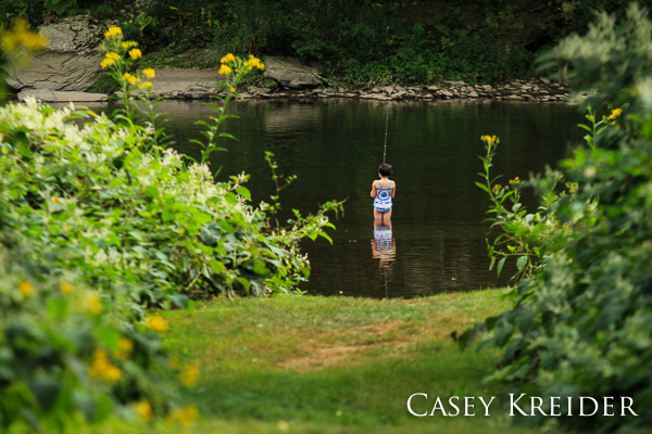A young girl fishes in Pine Creek at the Clark Farm parking area in Lycoming County.