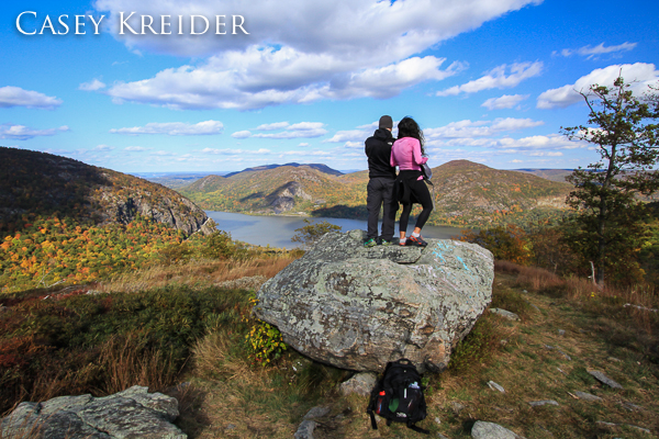 Hikers enjoy a view of Storm King Mountain, the Hudson River, Breakneck Ridge and Bull Hill (Mount Taurus) from North Point on Crow's Nest Mountain in Storm King State Park.