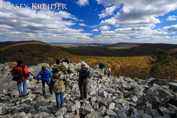 Birdwatchers and hikers admire the view from Hawk Mountain Sanctuary's North Lookout.