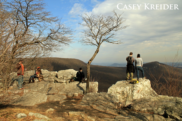 Hikers take in an easterly view from Pulpit Rock on the Appalachian Trail in Berks County.