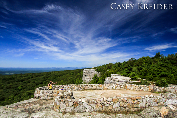 A couple snaps a photo at Sam's Point in Sam's Point Preserve on the Shawangunk Ridge, Ulster County, New York.