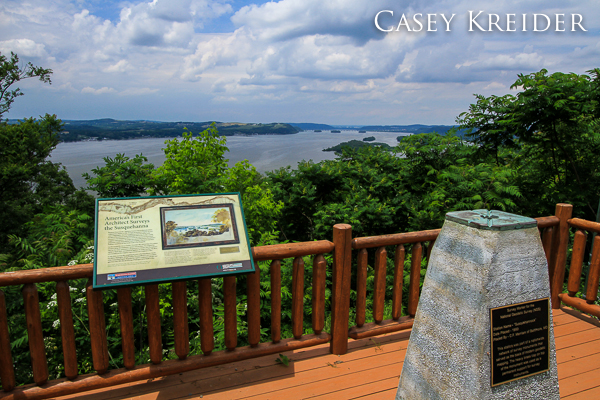 View over the Susquehanna River from the Turkey Hill observation platform and survey marker.