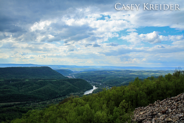 An encroaching shower over the town of Mill Creek and the swollen Juniata River from the Standing Stone Trail's Mill Creek Quarry View on Jacks Mountain in Huntingdon County.