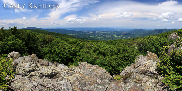 Multi-image, west-facing panorama of the Shenandoah Valley and Signal Knob, the northern peak of Massanutten Mountain (center) from North Marshall Mountain in Shenandoah National Park.