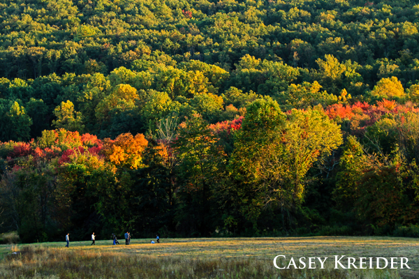 Autumnal hues are highlighted by the evening sun as a family enjoys relaxing in a meadow at Middle Creek Wildlife Management Area on Sunday.