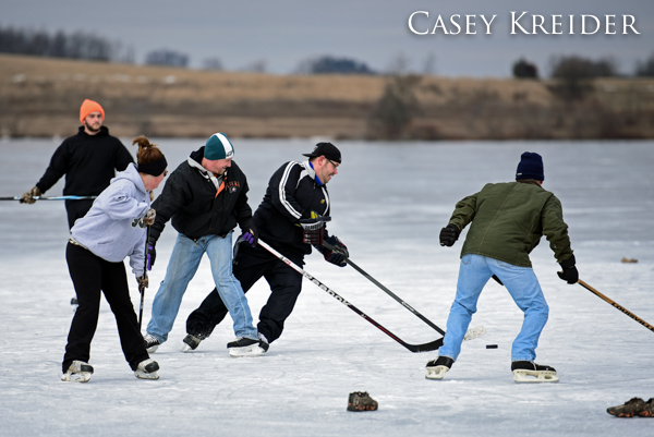 Small game of pond hockey on the frozen lake at Middle Creek Wildlife Management Area
