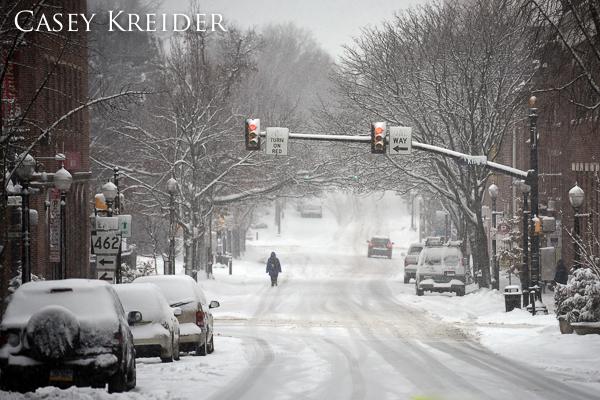 A pedestrian walks along South Duke Street in Lancaster Thursday morning.