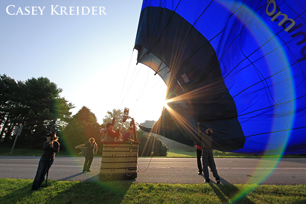 Members of the United States Hot Air Balloon Team corral one of their balloons after a landing along Willow Street Pike, south of Lancaster on Friday.